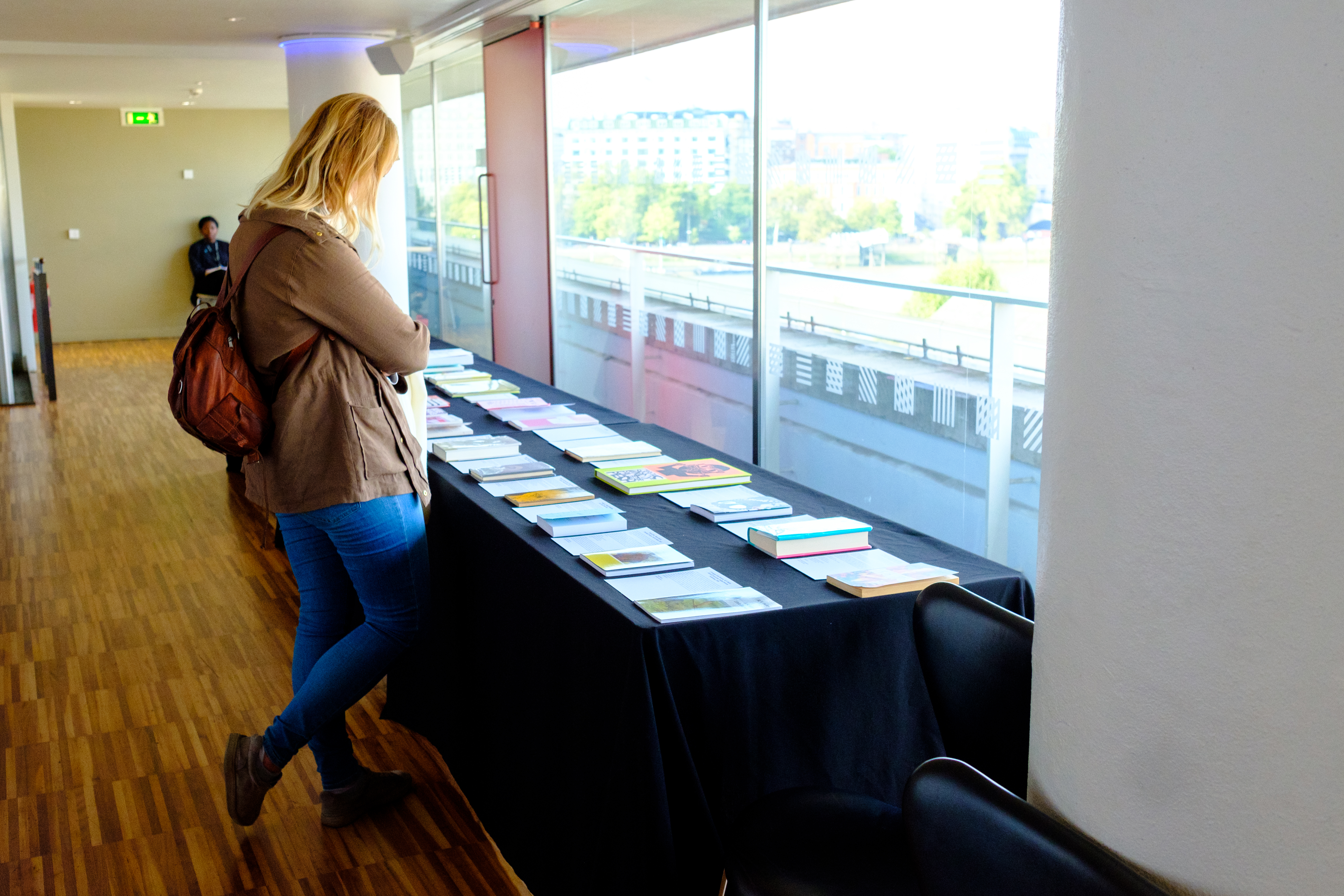 A lady looking over books at National Poetry Library Open Day