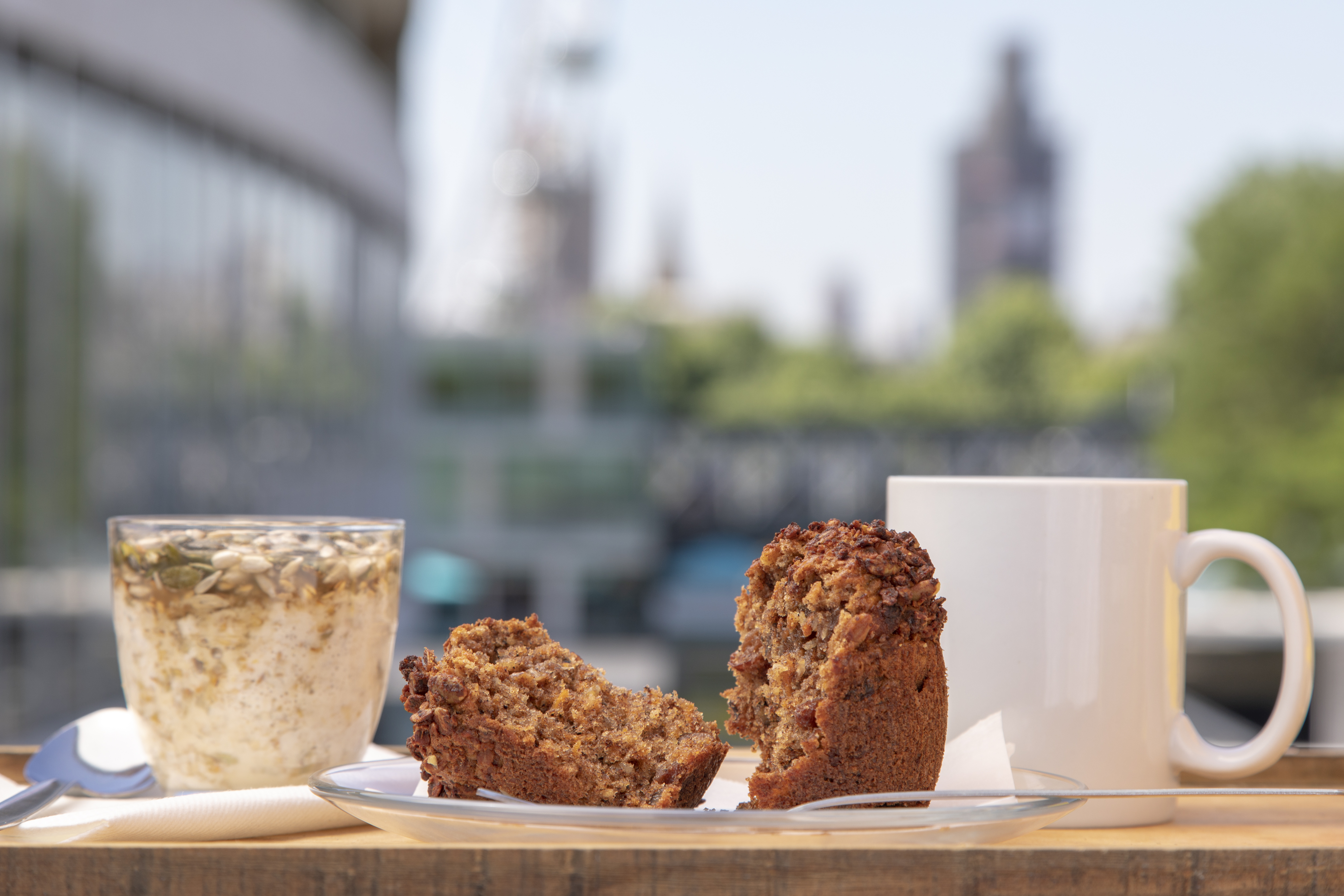 Concrete cafe, muffin, granola and cup of tea