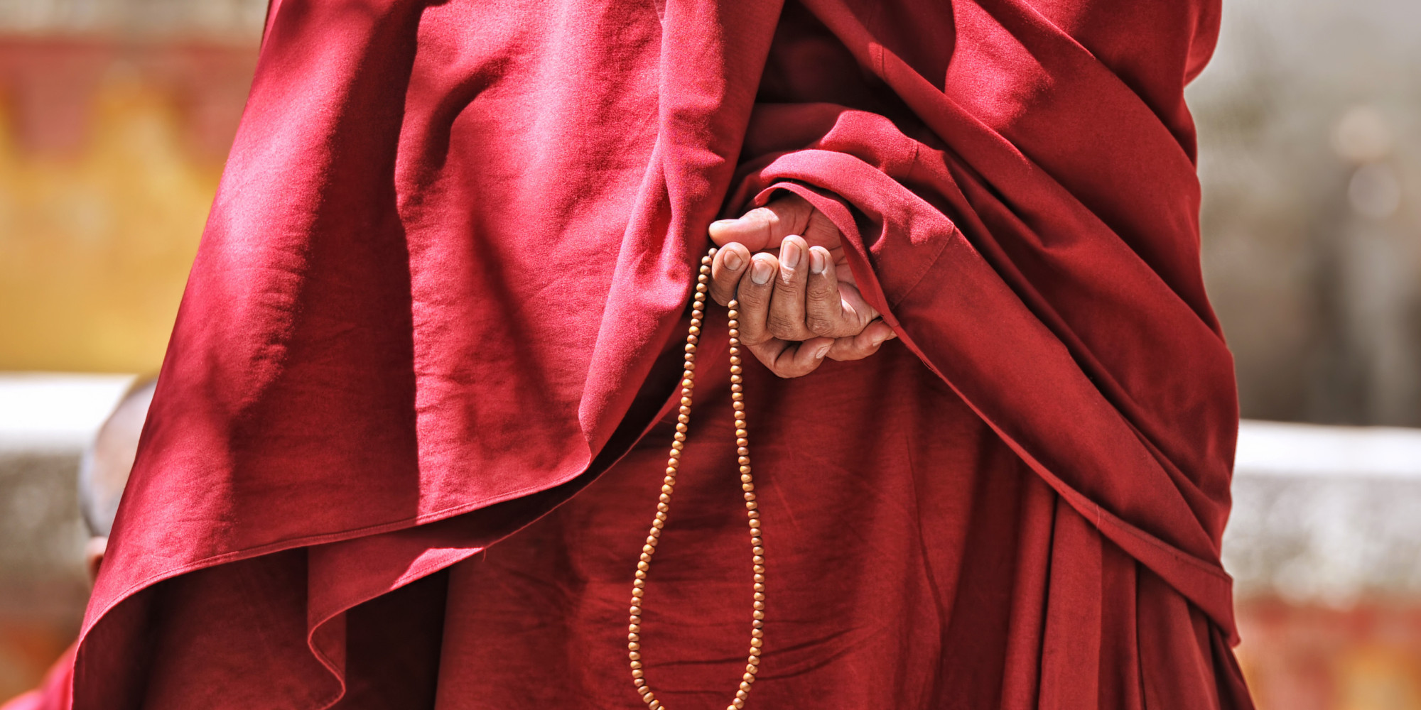 Prayer beads in monk's hand; Shutterstock ID 159387959; PO: aol; Job: production; Client: drone